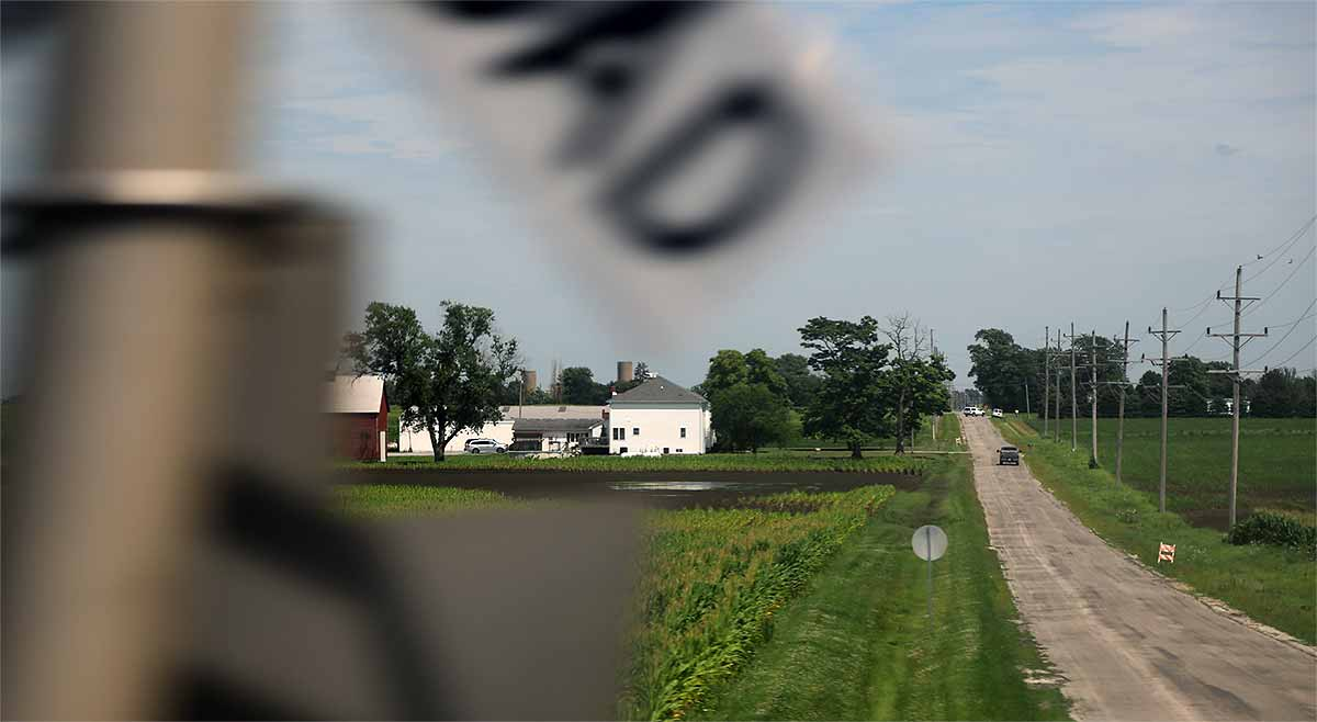 Illinois farm country: a farmstead, fields and crossing a county road