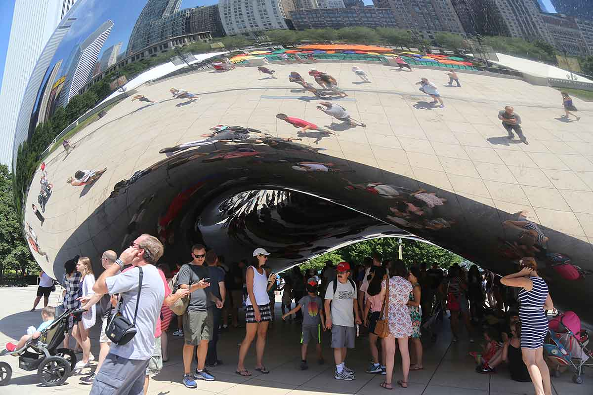 Cloud Gate (the Bean) in Millennium Park, surrounded by people exploring their reflections