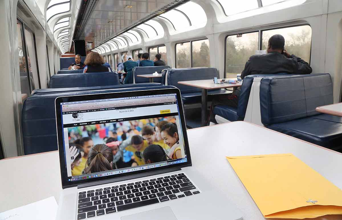 Computer set up on a table in the sightseer lounge car and I'm ready to build websites