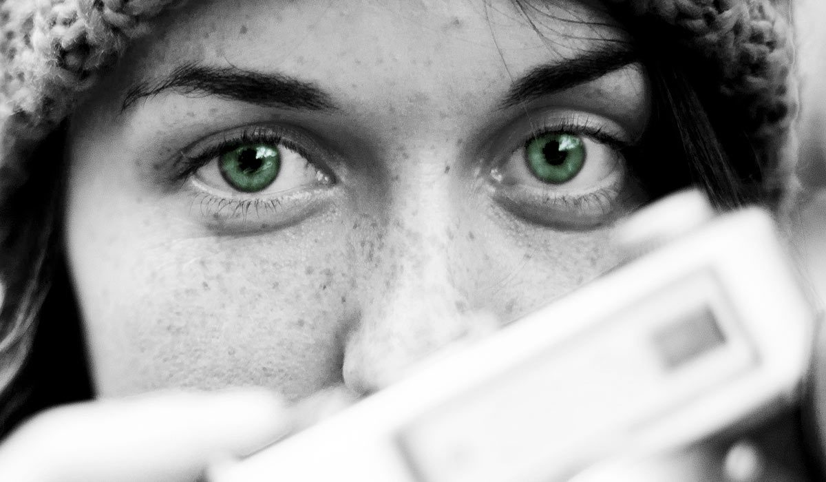 woman looking intently forward over a camera