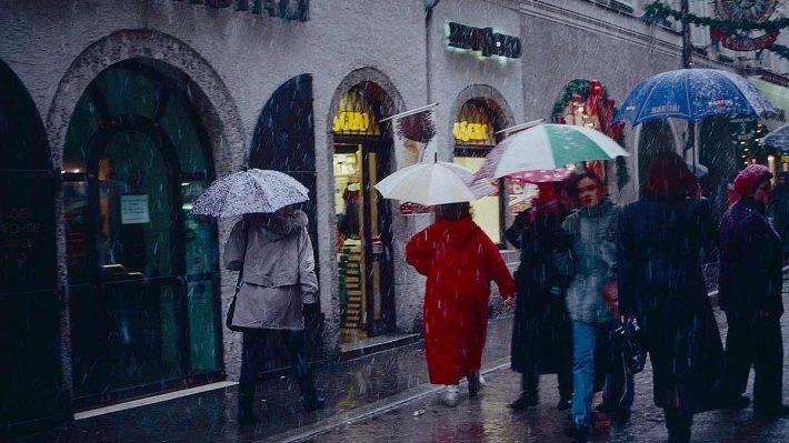 Salzburg street, pedestrians in snow
