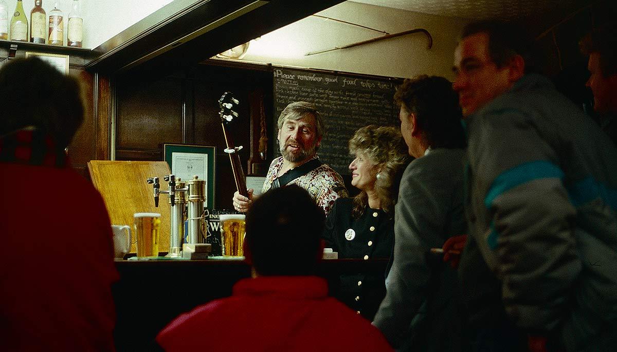 Patrons around the bar in Scottish pub