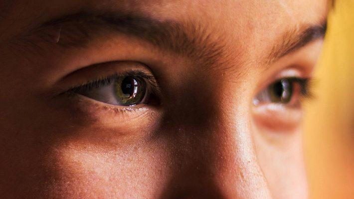 Closeup of eyes looking beyond the camera, seeing, perceiving