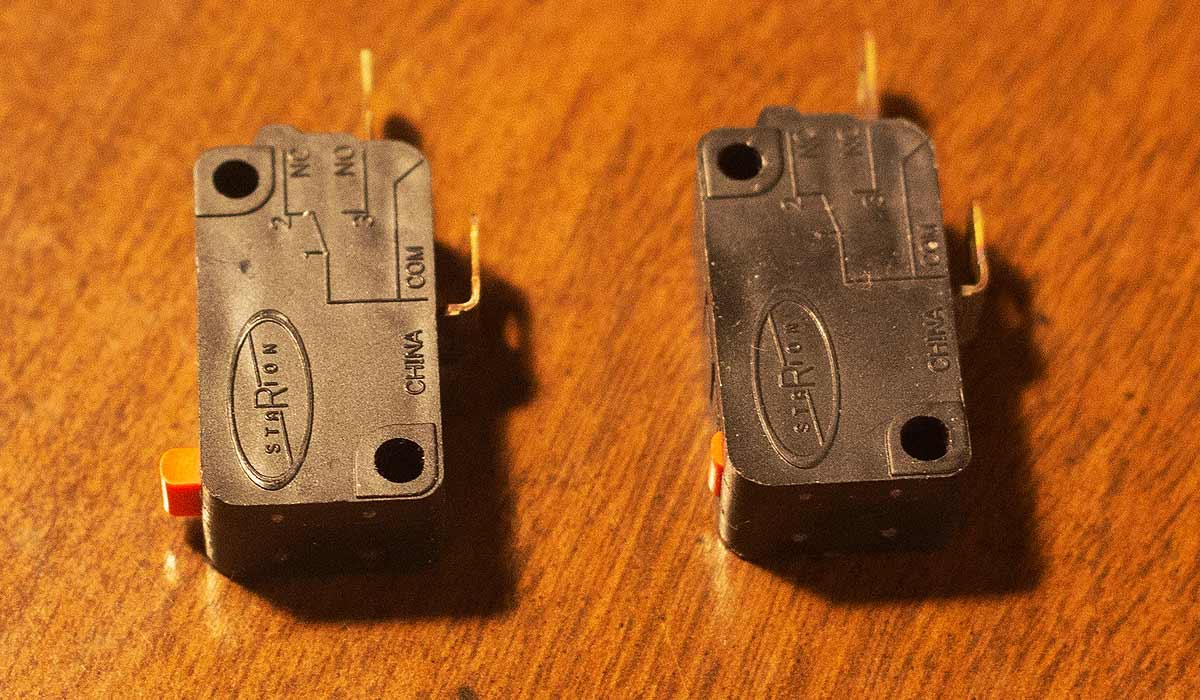The devil in the detail: Good switch on left, broken switch on right. The small orange tab is the moving part that broke on the right switch.