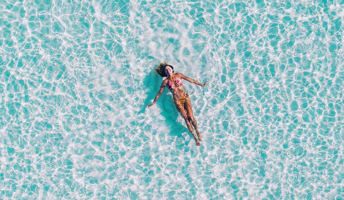 Birds eye view of woman floating in water