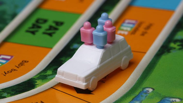 """The Game of Life"" board, car with tokens"