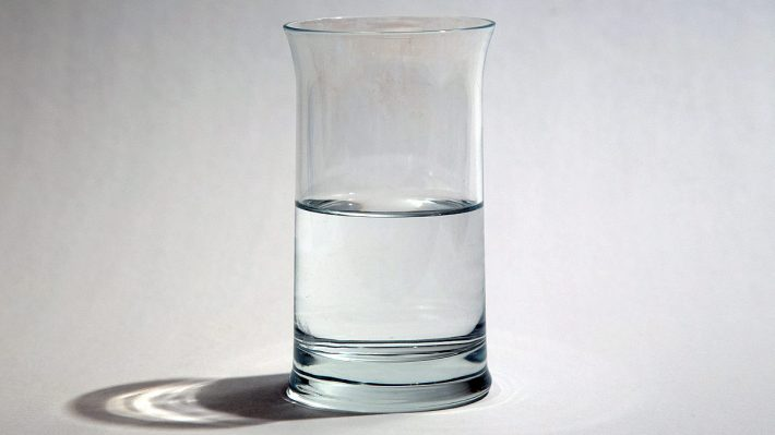 Glass of water filled to the half way mark — is it half full or half empty?