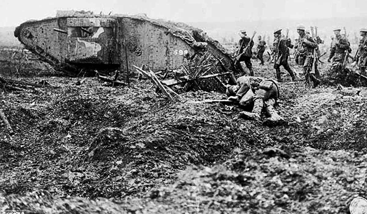 World War 1 battlefield - soldiers advancing behind a tank