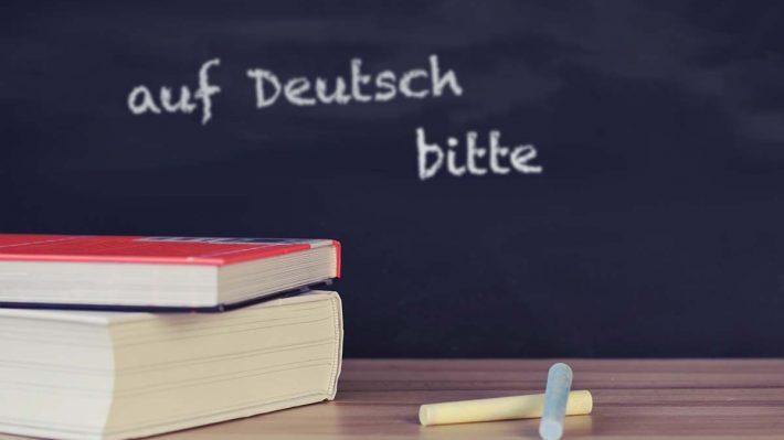 """Chalkboard with text """"Auf Deutsch, bitte"""""""