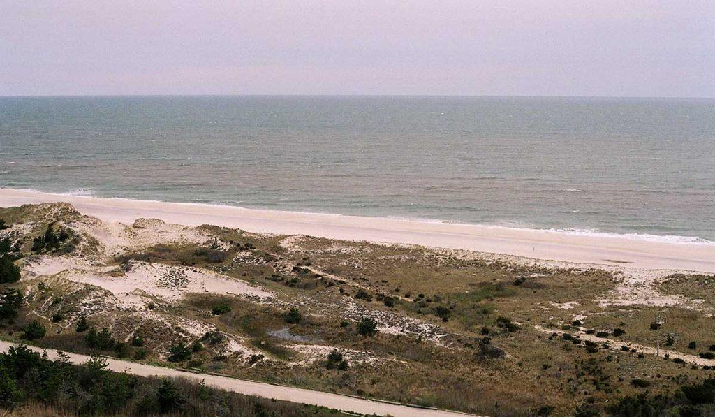 Fire Island, NY, sand dunes, beach and sea towards horizon