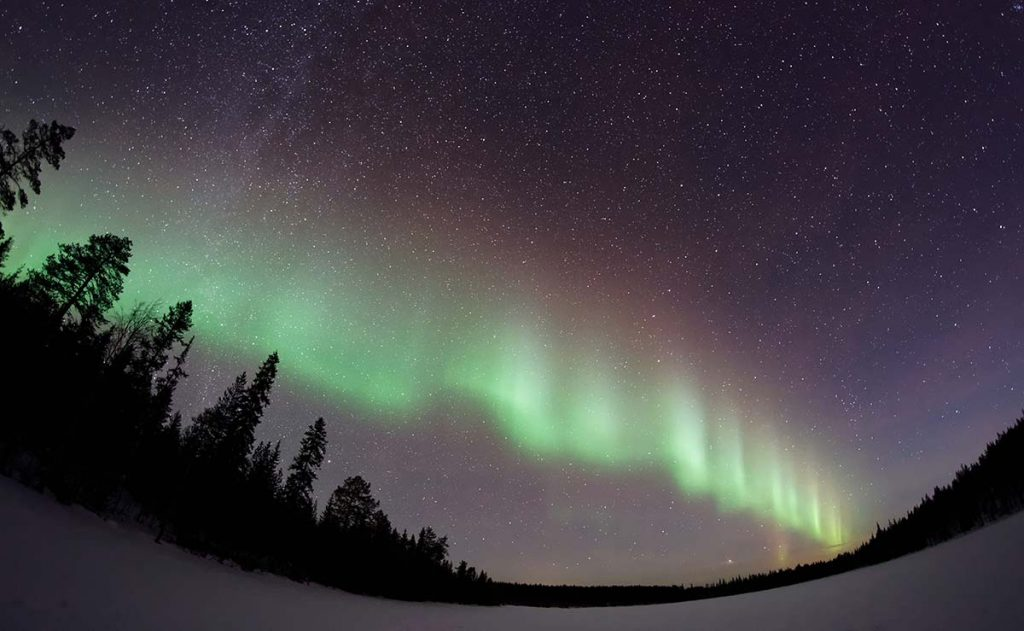 multi-colored curtain of Northern Lights in night sky