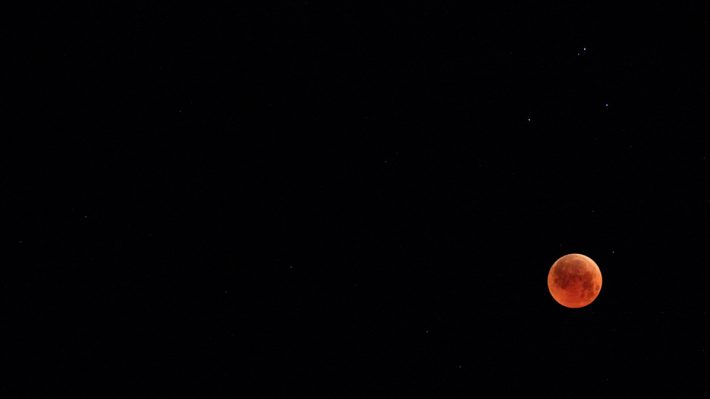 blood moon in black sky
