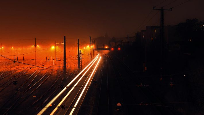 headlights of train, train tracks at night