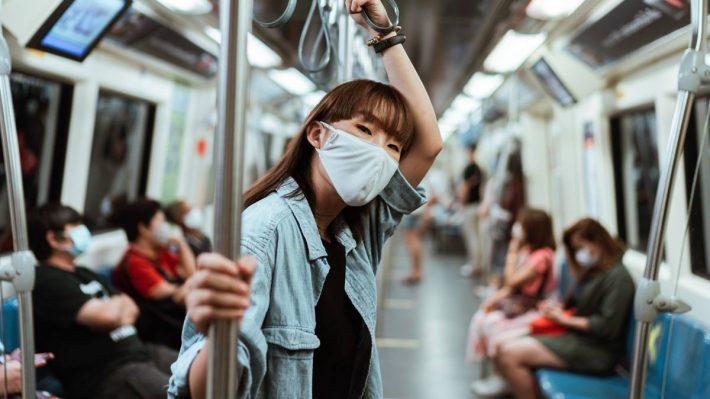 woman wearing mask on subway train