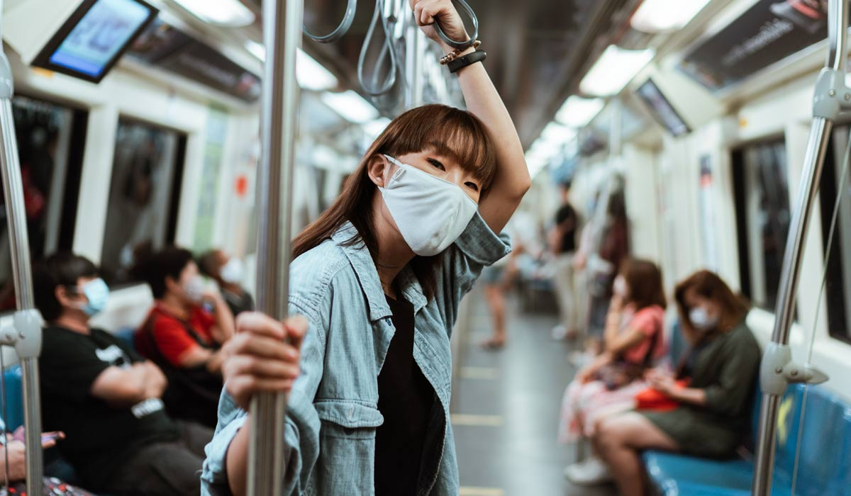 woman wearing mask on subway train